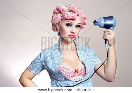 Unhappy housewife with hairdryer, similar available in my portfolio