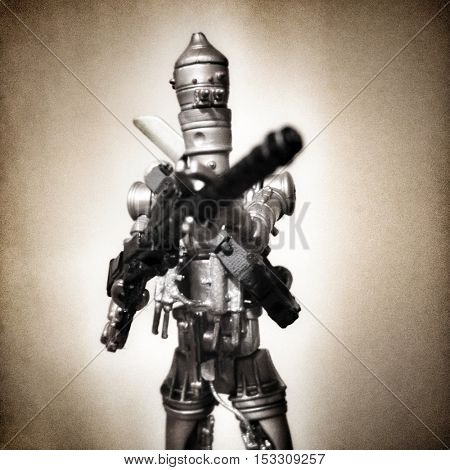 Star Wars Bounty Hunter Droids IG88 against a metallic background