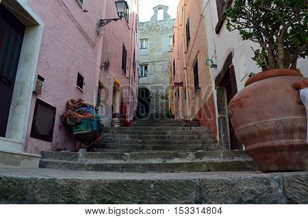 Narrow street with staris in Castelsardo fortress Sardinia Italy
