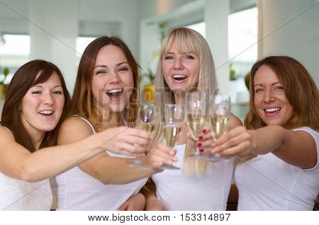Four Merry Women Partying And Toasting