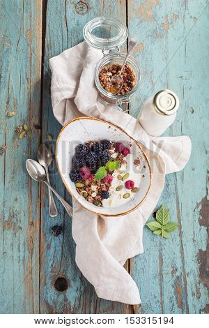 Delicious granola with blackberry. Healthy breakfast. Food background Vintage toned