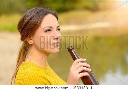 Young Woman Enjoying A Relaxing Beer
