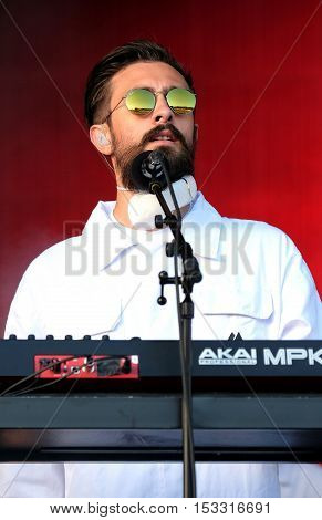 NEWPORT, ISLE OF WIGHT, UK - SEPTEMBER 11 2016: Keyboardist Kyle Simmons performing on stage with Bastille at Bestival festival on the Isle of Wight