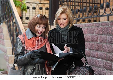 Young Businesswomen With Financial Reports