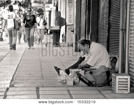 Person without hands selling things on the street