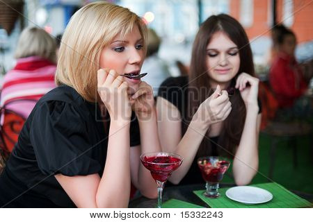 Two Young Women Eating A Dessert