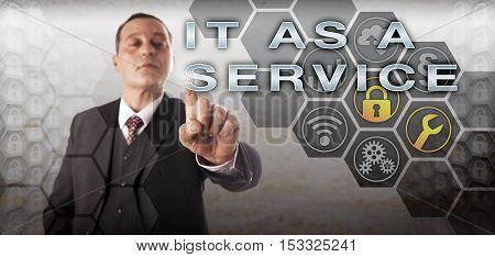 Confident service provider executive activating IT AS A SERVICE onscreen. Information technology concept and business metaphor for ITaaS which is an operational model of running IT like a business.