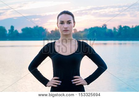 Young Woman Portrait In Early Morning During Sunrise