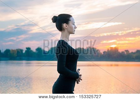 Young Woman Portrait In Early Morning During Colorful Sunrise