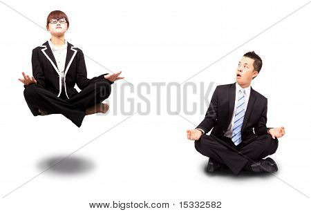 businesswoman and businessman in yoga lotus-pose and relaxing.