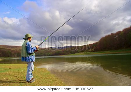A fisherman fishing on a lake in Macedonia