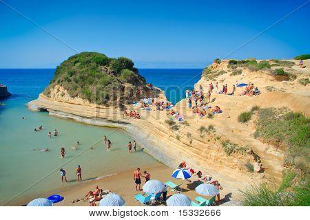People at the Canal dâ?? amour beach on Corfu island, Greece