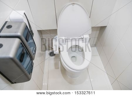 The toilet with electronic seat automatic flush