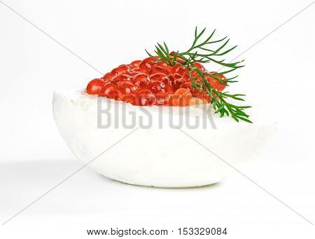 Hard-boiled egg with salted salmon roe filling isolated over white background