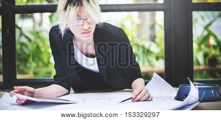 Asian Businesswoman Digital Tablet Architect Blueprint Concept