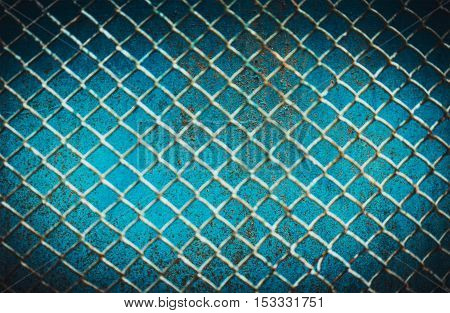 abstract blue background of cracked paint on the grid Rasfokus