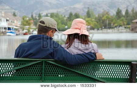 Couple By The Lake - Caring