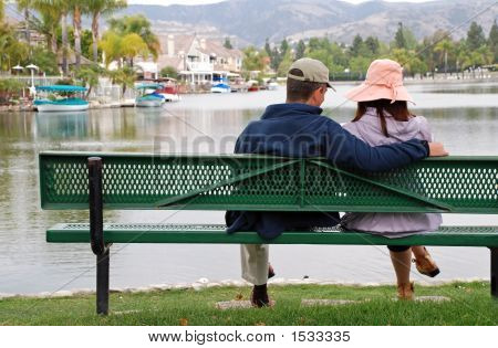 Couple By The Lake - Man Smiles