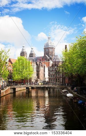 Church of St Nicholas, old town canal, at sunny spring day, Amsterdam, Holland, retro toned