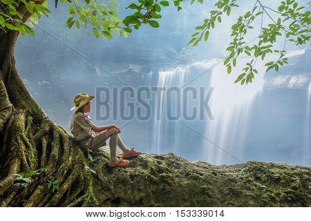Alone sad Scouts sit on Waterfall nature