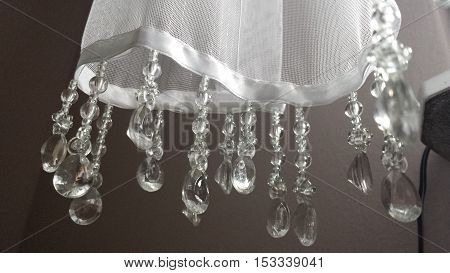 Closeup on the part of the white curtainsider with dangling crystals