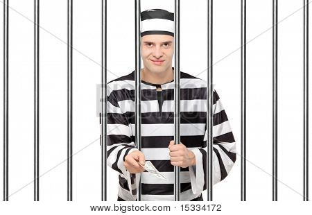 A prisoner in jail giving bribe isolated on white background