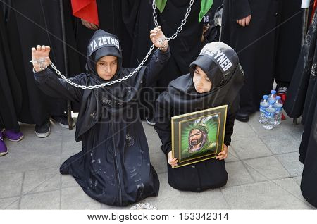 Istanbul Turkey - October 11 2016: Children takes part in an Ashura ceremony. Turkish Shia Muslims mourning for Imam Hussain. Caferis take part in a mourning procession marking the day of Ashura in Istanbul's Kucukcekmece district Turkey on October 11 201