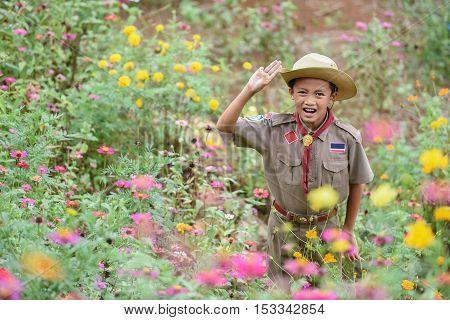 Happy boy in Cub Scout uniform nature park