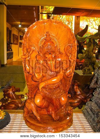Ubud Indonesia - April 12 2012: Carved wooden statue in shop at Ubud Indonesia