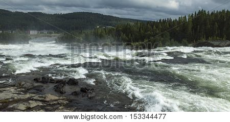 View of the Big Rapid, Storforsen and the surrounding environment. Village down in the valley.