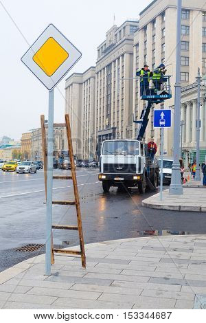 Moscow, Russia - October, 7, 2016: workers works on a lift on Ohotniy Riad street in a center of Moscow, Russia