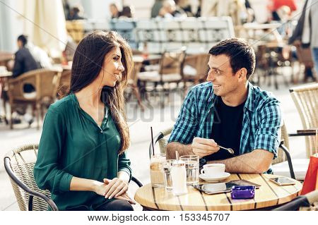 Young couple enjoying in coffee in the city center