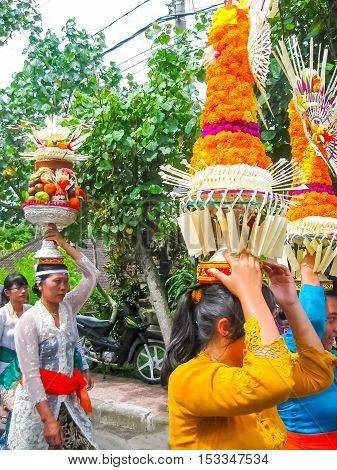 Ubud Indonesia - April 13 2012: The people at traditional Hindu ceremony at Bali in Indonesia. The women carring the gifts to the spirits.