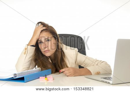young attractive sad and desperate businesswoman suffering stress and headache at office laptop computer desk looking worried depressed and overwhelmed in business problem concept