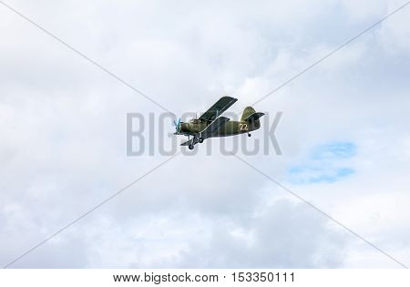 SAMARA RUSSIA - SEPTEMBER 11 2016: The Antonov An-2 is a Soviet mass-produced single-engine biplane in flying against cloudy sky