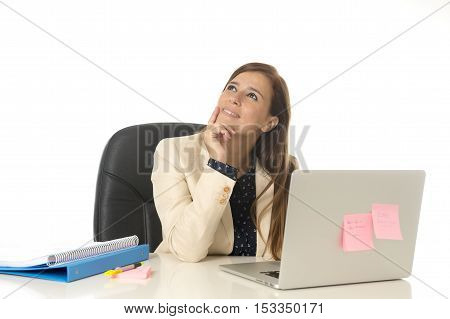 corporate portrait of young attractive businesswoman on her 30s sitting at office chair working at laptop computer desk smiling happy looking thoughtful and pensive isolated on white background
