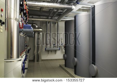 Heating stoves and pipe infrastructure in boiler room