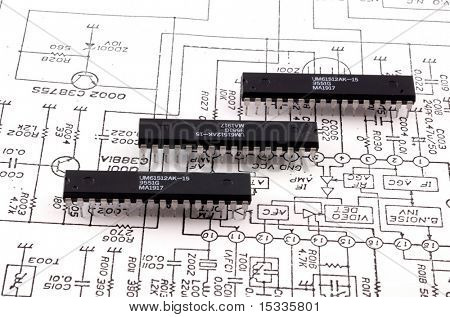 three chip situated on schematic background
