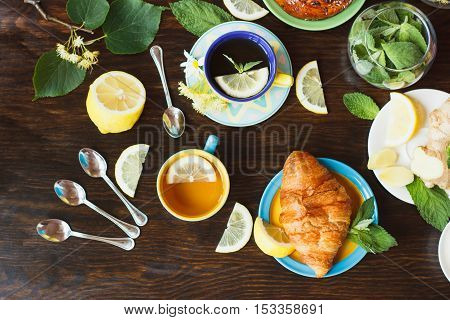 Cups With Green Tea And Lemon On The Wooden Background