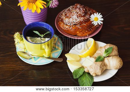 Cup With Green Tea And Lemon On The Wooden Background