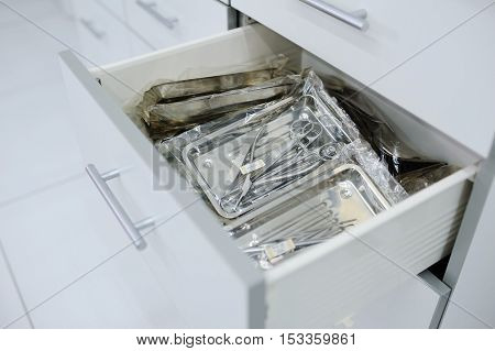 surgical instruments in a special box closeup