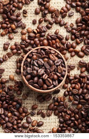 Brown Roasted Coffee Beans In Bowl On Sackcloth