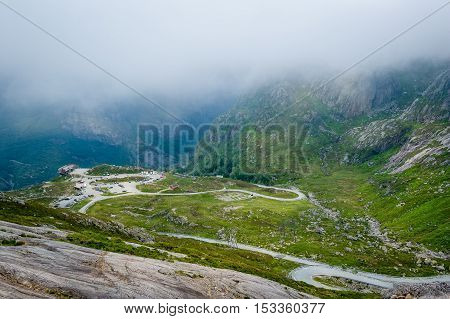 Mountain serpentine roads and parking at the start of touristic hiking path to famous Kjerag stone. Norway, Lysefjord