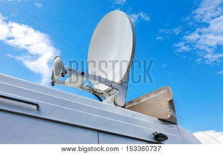 Satellite dish mounted on the roof of mobile television station