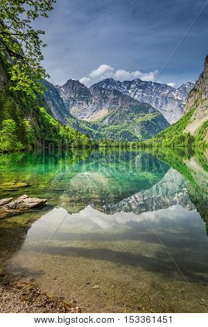 Mirror Reflection Of The Alps In Green Obersee Lake, Germany
