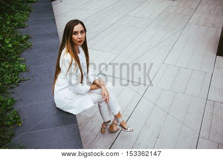 Stylish female with red lipstick is resting at square between work break. Copy-space area for your text or design