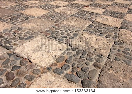 Cobblestone ground of the famous monastery of Saint Catherine, Santa Catalina, in Arequipa, Peru. It belongs to the Dominican Second Order. It's built predominantly in the Mudejar style in 1579.