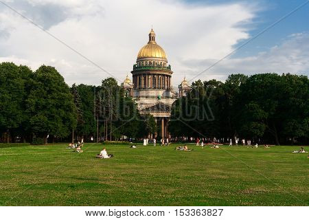 People relax next to St. Isaac's Cathedral, St. Petersburg