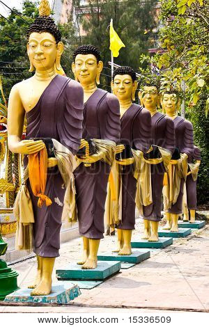 Row Of Monks Receive Food