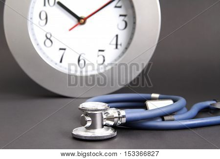 watch and stethoscope on an isolated surface